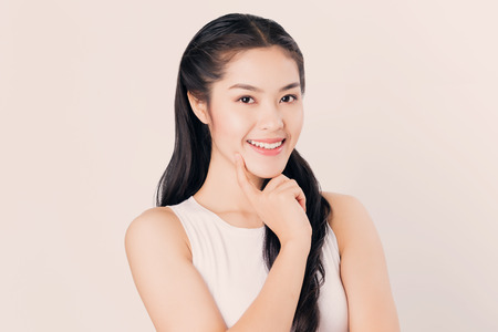 young happy Asian woman thinking with smiley face.