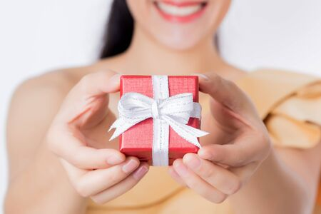 celebration smiley: Close up happy women hand holding red gift box, present.