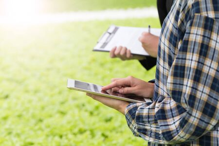 close up farmer checking agriculture's quality by using tablet technology to control.