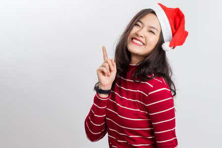 Young happy beauty Asian woman wearing red hat, with smiley face isolated on white background. Stock Photo
