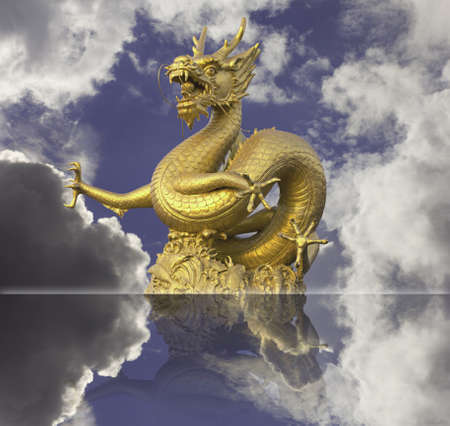 golden chinese dragon statue on blue sky background