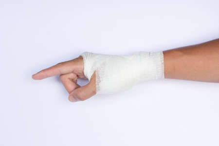 broken hand in cast isolated on white background