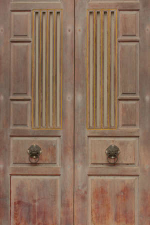 chinese door handles on wood doors in vertical