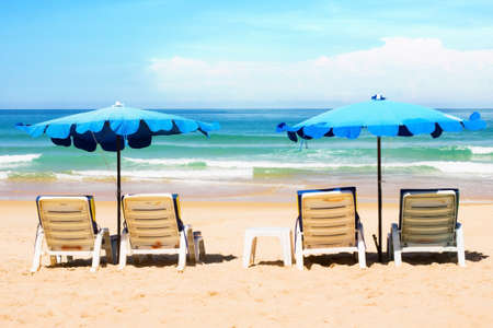 Beach chairs and with umbrella on the beach photo