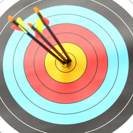 failed attempt: Three Arrow hit goal ring in archery target Stock Photo