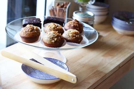 delicious homemade muffins over wooden board  Stock Photo
