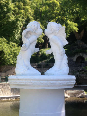 Gentle kissing angels in the garden. Ideal for greeting cards for the St. Valentines Day (February 14) Stock Photo