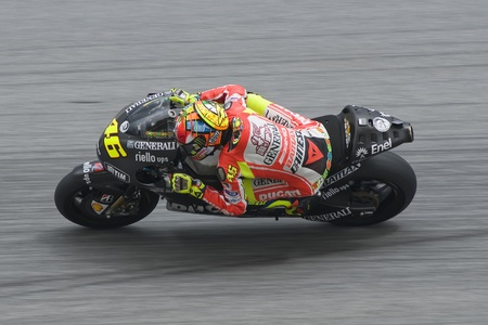 SEPANG, MALAYSIA - MARCH 1: Italian Valentino Rossi of Ducati Team takes a corner at the 2nd MotoGP testing on March 1, 2012 in Sepang, Malaysia.  Editorial