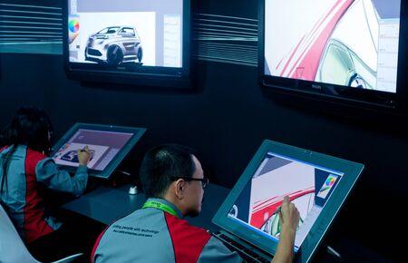 KUALA LUMPUR, MALAYSIA - DEC 8: An unidentified artist showcases a digital  sketching of a concept car during Kuala Lumpur International Motor Show on December 8, 2010 in Kuala Lumpur Malaysia. Stock Photo - 13745378