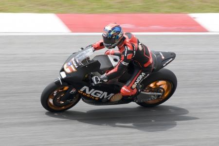 cornering: SEPANG,MALAYSIA-MARCH 1: Colin Edwards of NGM Mobile Forward Racing at 2012 MotoGP Official Winter Test Sepang 2 on Mar. 1, 2012 in Sepang, Malaysia. Editorial