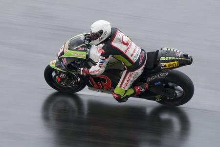 Sepang, Maleisië-FEB 29: Hector Barbera van Pramac Racing Team neemt hoek op natte baan op 2012 MotoGP Winter Test 2 op 29 feb 2012 in Sepang, Maleisië. Redactioneel