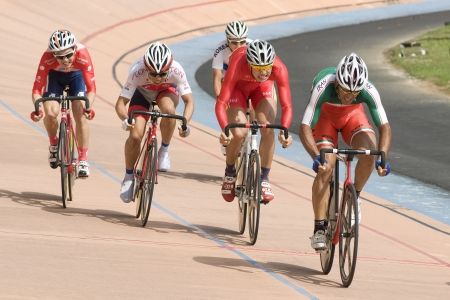 keirin: KUALA LUMPUR-FEB 11: Riders from various Asian countries participate in the track event during the Asian Cycling Championships 2012 at Kuala Lumpur Velodrome, Malaysia on February 11, 2012  Editorial