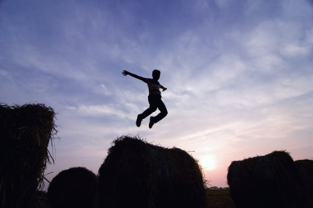silhouette of man jumping in sunset