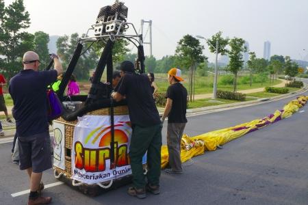PUTRAJAYA, MALAYSIA - MARCH 31: Australian Crew set up the hot air balloon during 5th Putrajaya International Hot Air Balloon Fiesta 2013 on March 31, 2013 in Putrajaya, Malaysia.                             Editorial