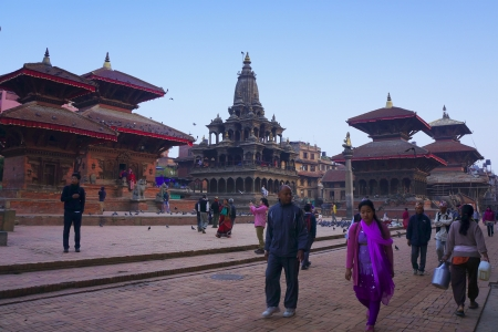 KATHMANDU, NEPAL - MARCH 23: Local people busy in their everyday life on Patan Durbar Square,Nepal on march 23, 2013 in Kathmandu.The Durbar Square located in the heart of Kathmandu listed as one of Cultural World Heritage site by UNESCO.                  Editorial