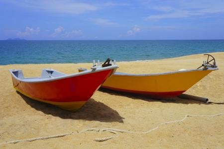 redang: A boat on Dungun beach, Terengganu, Malaysia.