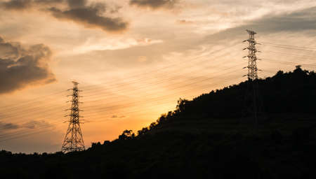 Electricity pylons on a hill  photo