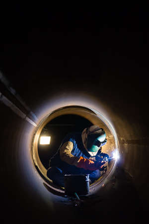 Workers welding work at night in the pipeline. Stock Photo