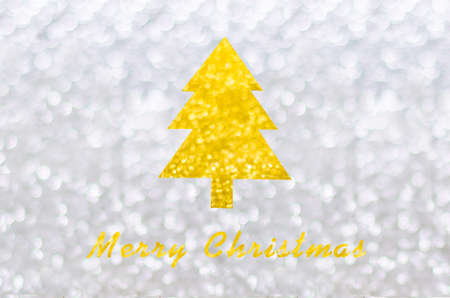 Golden Christmas tree on silver bokeh background