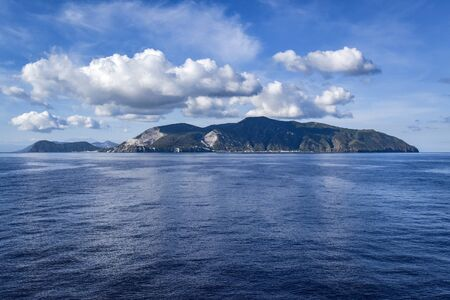 the island of Lipari seen from the island of Salina on a day of calm sea and blue sky Archivio Fotografico