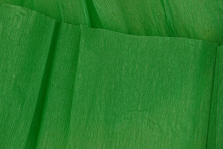 Green background of a roll of crumpled paper