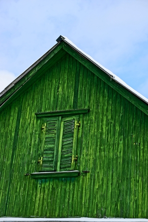 attic: Green attic with window shuttered