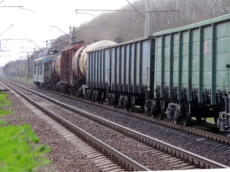 Commodity train with cars and tanks Stock Photo