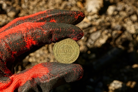 Copper old coin in hand Stock Photo