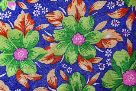 fabric textures: Texture of a fabric with a pattern and flowers on a piece of cloth Stock Photo