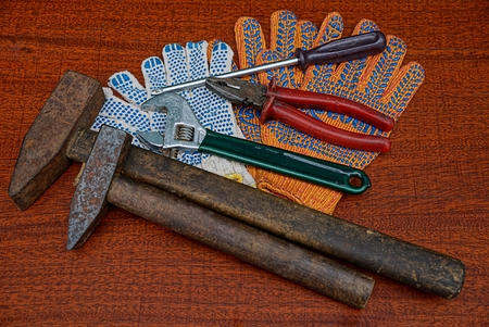 A set of construction tools and work gloves on the table