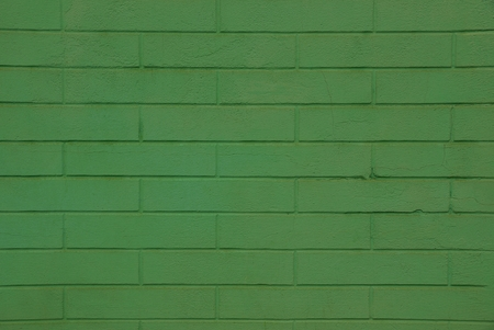 Green texture of the brickwork of a residential building 版權商用圖片