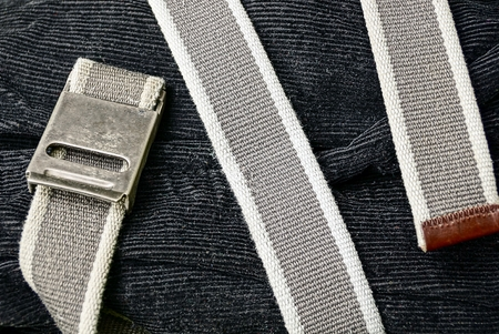 fasten: The gray belt is wound on black velveteen trousers