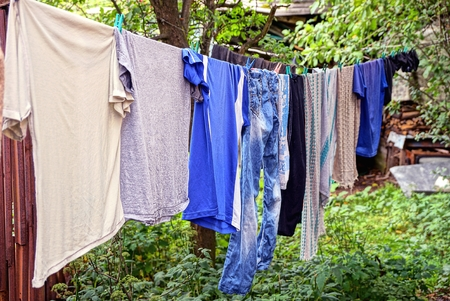 Clothing and linen dries after washing in the yard