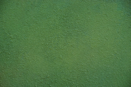 Green background from a part of the concrete foundation of a residential building 版權商用圖片