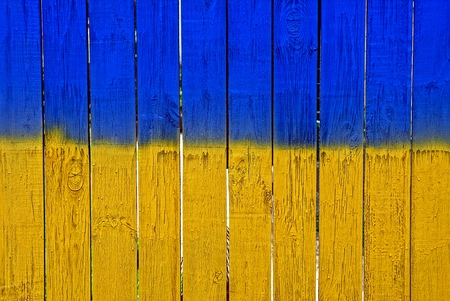 Bright texture of a yellow blue wooden fence