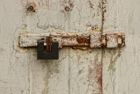 deterrence: Large iron padlock on the bolt on the metal door