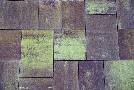 durable: Stone texture of gray brown paving slab on the road