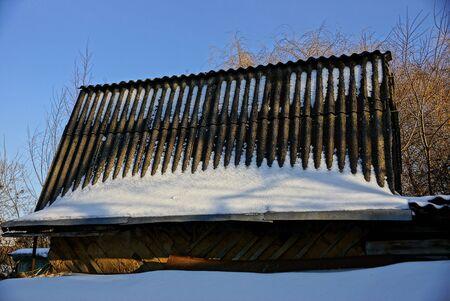 slate roof: Slate roof under snow Stock Photo