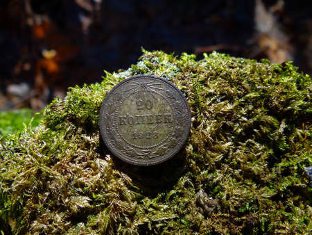 Soviet silver coin on the green moss Stock Photo