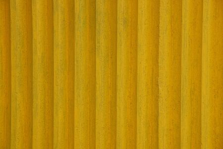 Yellow texture of old wooden fence boards