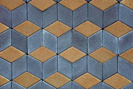 Background of a fragment of a colored square paving tiles on the road Banco de Imagens