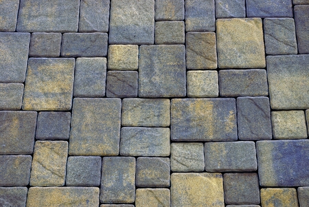 Colored background of stone paving tiles on the road Banco de Imagens
