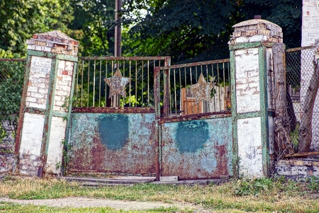 Old iron gates and a brick fence in the park
