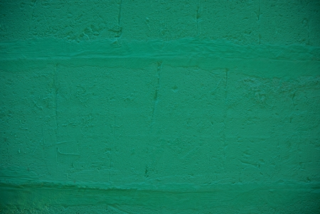 Part of a green concrete wall on a private building