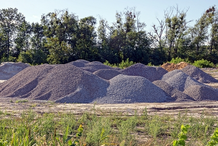 empty warehouse: Heaps of construction rubble in the trees in the field Stock Photo