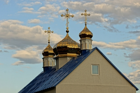 street creed: A prayer house with beautiful domes and crosses on the roof