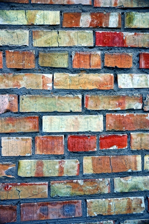 colored texture of a fragment of a brickwork on the wall of the house