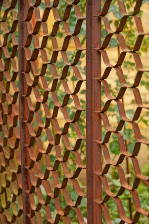 Iron texture from the old rusty mesh fence in the street Stock Photo