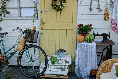 Home decoration in the yard near the wall with a door Stock Photo