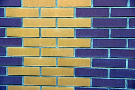 Stone texture of colored bricks on the wall of the house